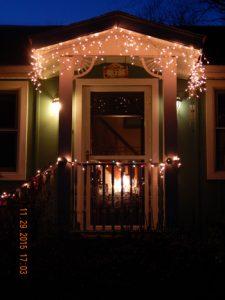 Christmas-lights-w-dog-prints-on-door-2015-small
