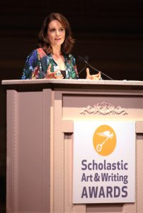 Emmy and Golden Globe Award-winning actress, writer and producer Tina Fey addresses students, their families and educators at the National Ceremony for the 2019 Scholastic Art & Writing Awards held at Carnegie Hall in New York, Thursday June 6, 2019. (Stuart Ramson/AP Images for Alliance for Young Artists & Writers)